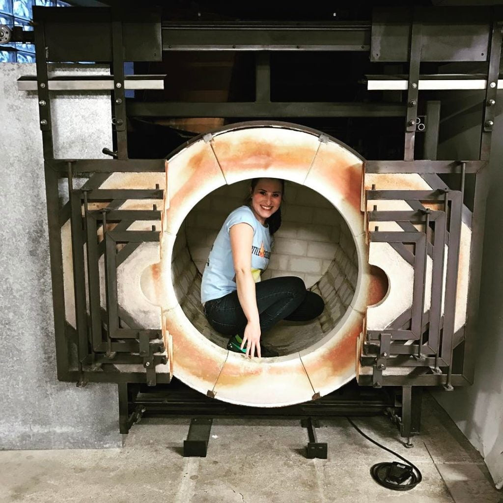 Becca in large reheating chamber
